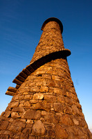 Wide angle view of the Ballycorus (former) Leadmines chimney above Shankill on Carrickgollagan Hill.