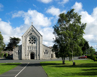Another view of St Anne's Church - the Kiltuck Cross is underneath the large tree to the right.